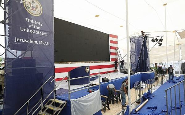 Workers prepare the stage for the opening of the new US Embassy in Jerusalem.