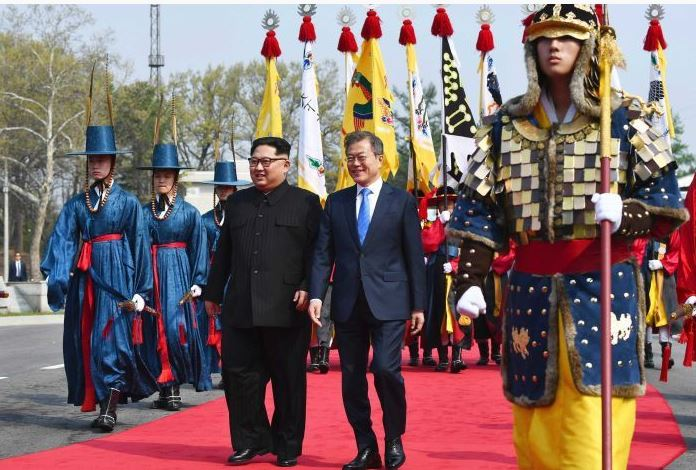 Kim Jong-un and Moon Jae-in walk together at the border village of Panmunjom